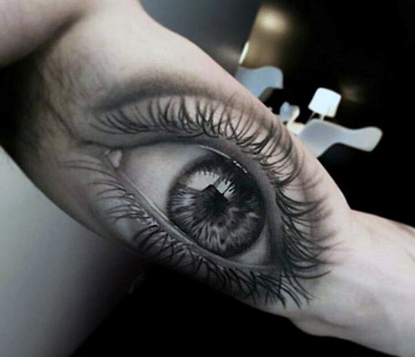 Bicep eye tattoo